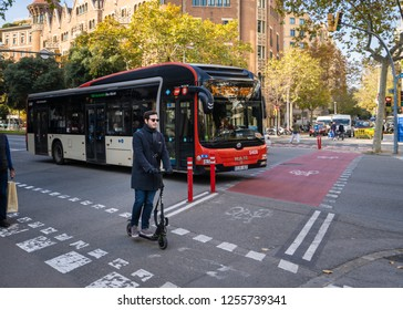 Barcelona, Spain. December 2018. Electric scooter riding in a street of Barcelona. EU cities like Barcelona have already prepared specific regulations since the use of these devices became a 'boom'