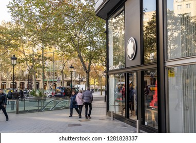 Barcelona, Spain. December 2018: People walking in front of an official Montblanc store in Barcelona's luxury shopping street of Passeig de Gracia. Travel and luxury shopping editorial.