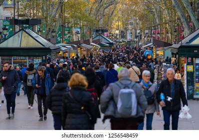 Barcelona, Spain. December 2018Crowd of anonymous people walking on the Rambla of Barcelona. Ramblas are very popular with tourists and it has also suffered from the attention of pickpockets