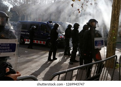 Barcelona / Spain - December 21, 2018: Anti clash riots police prepare to charge against demonstrators during the protest against the celebration of the Spanish ministers council in Barcelona