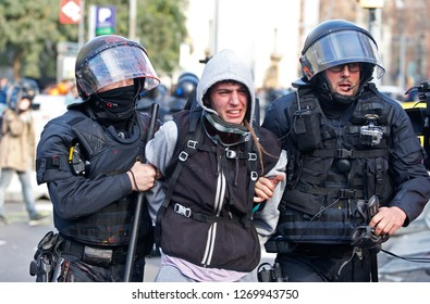 Barcelona / Spain - December 21, 2018: Anti clash riots police arrest a demonstrator during the protest against the celebration of the Spanish ministers council in Barcelona
