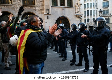 Barcelona / Spain - December 21, 2018: Anti clash riots police charge against demonstrators during the protest against the celebration of the Spanish ministers council in Barcelona
