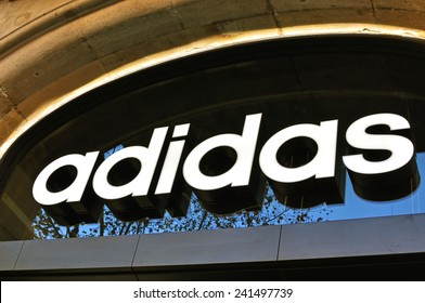 BARCELONA, SPAIN - DECEMBER 21: Logo of Adidas flagship store in the street of Barcelona on December 21, 2014. Adidas is a world famous sport brand.