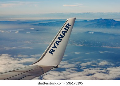 BARCELONA, SPAIN - DECEMBER 23, 2015: Low-cost airline RYANAIR logo on airplane's wing