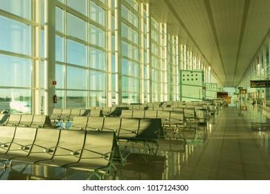 BARCELONA, SPAIN - DECEMBER 29, 2017: Boarding lounge in Barcelona International Airport El Prat interior . Airport is one of the biggest in Europe