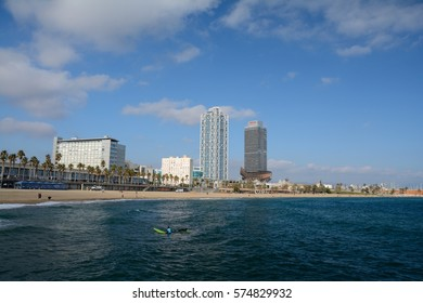 Barcelona, Spain - December 3, 2016: Skyscrapers at beach in Barcelona, Spain. Unidentified people visible.