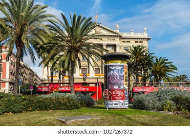 Barcelona, Spain - December 5, 2016: Advertising columns or Morris columns with placards on the street in the Port Vell in Barcelona, Spain.