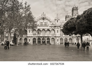 Barcelona, Spain - December 5, 2016: Neoclassical building Aduana in the Square of the Gate of Peace at Port Vell in Barcelona, Catalonia, Spain. Black-and-white photo in Sepia Toned.
