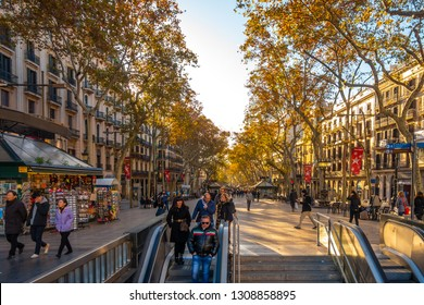 BARCELONA, SPAIN - DIC 02, 2018:  La Rambla in Barcelona, Spain. La Rambla is a street in central Barcelona, between El Raval and Barri Gotic districts
