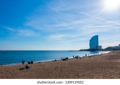 BARCELONA, SPAIN - Dic 02 2018- View of famous Barceloneta beach and W Barcelona (known as Hotel Vella) in background. Barceloneta district (Ciutat Vella)