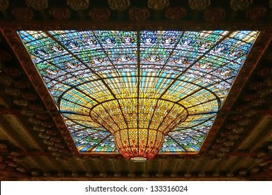 BARCELONA, SPAIN - FEB 3: Palau de la Musica Catalana skylight of stained glass designed by Antoni Rigalt i Blanch whose centerpiece is an inverted dome in shades of gold, on Feb 3, 2013 in Barcelona