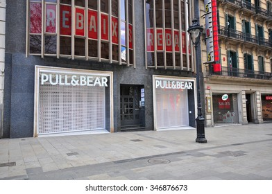 BARCELONA, SPAIN - FEBRUARY 1: Pull and Bear store in the street of Barcelona on February 1, 2015. Pull and Bear is a casual clothing brand based in Spain.