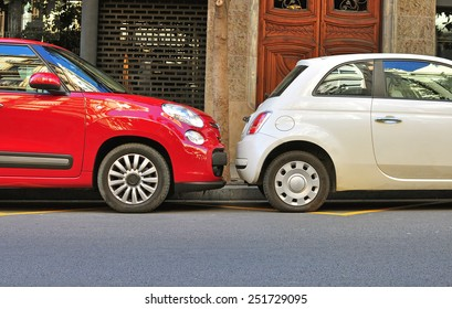 BARCELONA, SPAIN - FEBRUARY 1: Two cars parked in the street of Barcelona on February 1, 2014. Barcelona is the capital of Catalonia and second largest city of Spain.