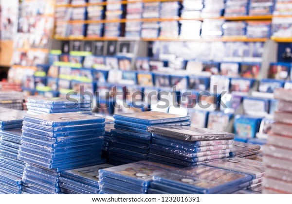 BARCELONA, SPAIN - FEBRUARY 15, 2018: CD and DVD store offering huge selection of movies stacked on piles