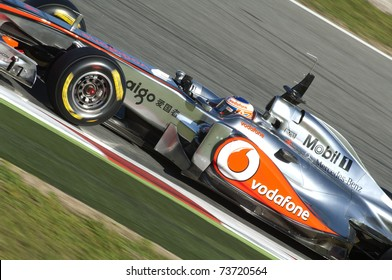 BARCELONA, SPAIN - FEBRUARY 18: Jenson Button drives for the McLaren team during testing at the Circuit de Catalunya February 18, 2011 in Barcelona, Spain.