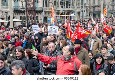 BARCELONA, SPAIN - FEBRUARY 19: hundreds of thousands of people across Spain demonstrate against the conservative governments new labor laws. Passeig de Gracia on February 19, 2012 in Barcelona, Spain