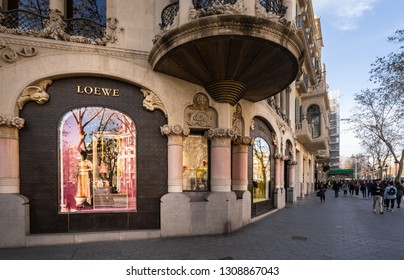 Barcelona, Spain. February 2019: People walking in front of Loewe shop with in Barcelona's luxury shopping street of Passeig de Gracia. Consumerism concept.