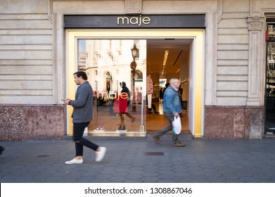 Barcelona, Spain. February 2019: People walking in front of maje shop with in Barcelona's luxury shopping street of Passeig de Gracia. Consumerism concept.
