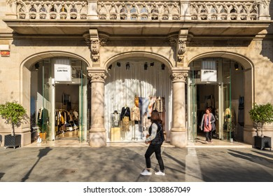 Barcelona, Spain. February 2019: People walking in front of Other Stories shop with in Barcelona's luxury shopping street of Passeig de Gracia. And Other Stories is part of H M brand.