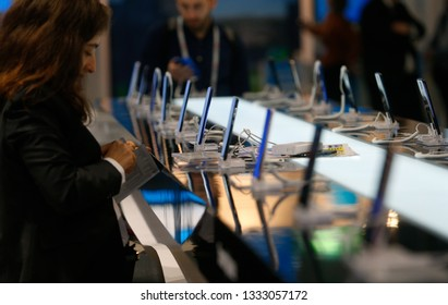 Barcelona / Spain - February 25 2019: Visitors test and picture new mobile models during the Mobile world congress 2019 in Barcelona.