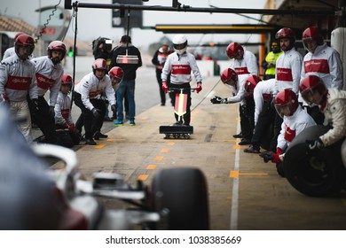 Barcelona, Spain - February 26-27, 2018: Pit stop mechanics at Formula One testing at Catalunya circuit in Barcelona, Spain.