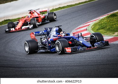 Barcelona, Spain - February 27 / March 2, 2017: Daniil Kvyat, Toro Rosso F1 Team driver on track ahead of Ferrari at Formula One testing at Catalunya circuit in Barcelona, Spain.