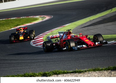 Barcelona, Spain - February 27 / March 2, 2017:  Kimi Raikkonen on Ferrari leads Red Bull Racing F1 team on track at Formula One testing at Catalunya circuit in Barcelona, Spain.