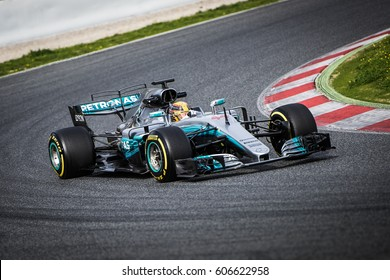 Barcelona, Spain - February 27 / March 2, 2017: F1 test days. Lewis Hamilton, Mercedes AMG Petronas F1 Team driver attack on track at Formula One testing at Catalunya circuit in Barcelona, Spain.