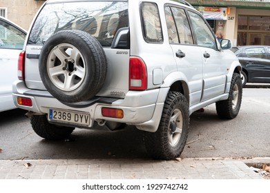 Barcelona, Spain; February 5, 2021: modified off-road vehicle with larger wheels. Suzuki Grand Vitara 2.0TD silver color High Lift