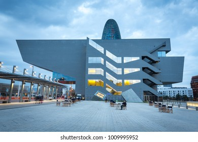 BARCELONA, SPAIN - FEBRUARY 7, 2017: The Disseny Design Museum, designed by MBM Arquitectes and Agbar tower in Barcelona, Spain