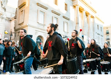 Barcelona, Spain - February 9, 2018: batucada parade in the streets of barcelona during popular carnival celebrations