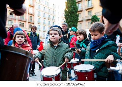 Barcelona, Spain - February 9, 2018: children learn to play  batucada in the streets of barcelona during popular carnival celebrations in the city center