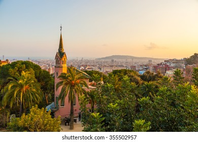 BARCELONA, SPAIN - JAN 15, 2012: View over Barcelona from the Park Guell, a public park designed by the architect Antoni Gaudi. The park was opened in1926. In the foreground Gaudi's house.