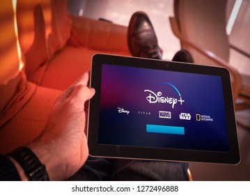 Barcelona, Spain. Jan 2019: Man holds a tablet with the new Disney plus on screen . Disney + is an online video streaming subscription service, set to launch in the US in September.Illustrative