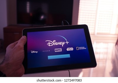 Barcelona, Spain. Jan 2019: Man holds a tablet with the new Disney plus on screen . Disney+ is an online video streaming subscription service, set to launch in the US in September.Illustrative