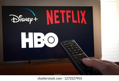 Barcelona, Spain. Jan 2019: Man holds a remote control With the new Disney+ screen on TV. Disney+ is an online video streaming subscription service.Disney + is set to compete with other video