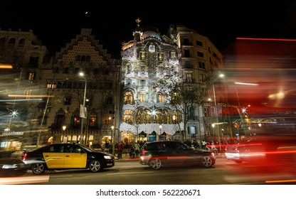 Barcelona, Spain - January 03 2017: Night traffic on the Passeig de Gracia street in the background of House of Batllo
