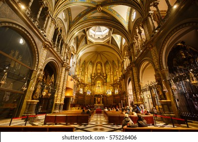 Barcelona, Spain - January 06 2017: Some people visit to church of the Benedictine monastery of Santa Maria de Montserrat, is lies about 45 km northwest of Barcelona