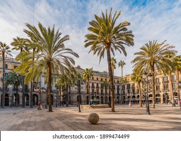BARCELONA, SPAIN- JANUARY 16, 2020: Unusual view of the iconic Plaça Reial square (Plaza Real) in Barcelona city center, during a sunny day of January