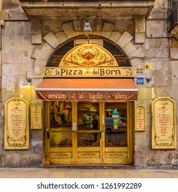 BARCELONA, SPAIN, JANUARY - 2018 - Front view picturesque antique facade pizza restaurant at gothic district in barcelona city, spain