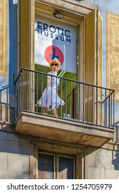 BARCELONA, SPAIN, JANUARY - 2018 - Woman dressing like marylin mornoe at balcony promoting the erotic museum of barcelona, spain