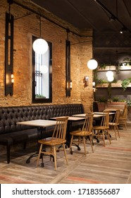 Barcelona / Spain - January 2020: Cozy coffee shop with warm tones and wooden floor. Interior design