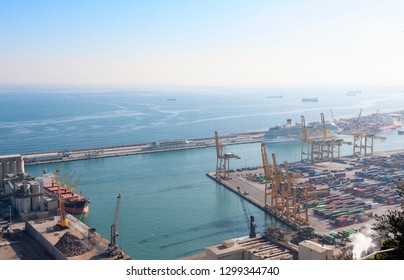 Barcelona, Spain - January 21, 2019: View from Montjuic Castle of Barcelona industrial port docked with ships, cranes and containers