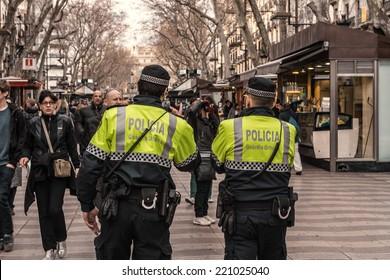BARCELONA, SPAIN - JANUARY 29: Policemen walk on the Ramblas, the famous street of the city on January 29, 2014 in Barcelona, Spain