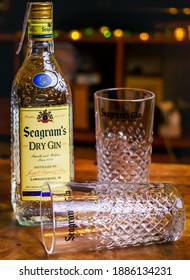 BARCELONA, SPAIN - JANUARY 3, 2021:  Bottle of Seagrams Gin with two glasses. The favorite gin to prepare gin and tonic (the best selling gin, produced since 1939).