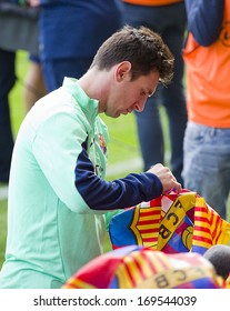 BARCELONA, SPAIN - JANUARY 3: Leo Messi signing autographs at FC Barcelona team in open doors training session at Mini Estadi stadium, with 13,200 spectators, on January 3, 2014, in Barcelona, Spain.