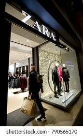 BARCELONA, SPAIN - JANUARY, 3: Shopper with bags entering Zara store on city centre on January 3, 2018 in Barcelona, Spain