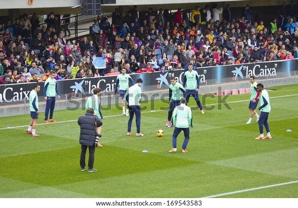 BARCELONA, SPAIN - JANUARY 3: Some players in action at FC Barcelona team in open doors training session at Mini Estadi stadium, with 13,200 spectators, on January 3, 2014, in Barcelona, Spain.
