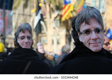 Barcelona, Spain - January 30, 2017: Concentration of people wearing a mask with the face of Carles Puigdemont on the day when it was supposed he was going to be voted president of Catalonia