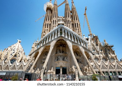 BARCELONA, SPAIN - JUL 12: Exterior of the Basiclica de la Sagrada Familia on July 12, 2018. The church was designed by Antonio Gaudi, to be completed in 2026.